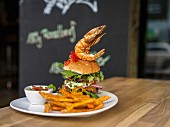 A giant burger with a prawn in a restaurant