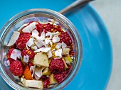Spelt muesli with berries and grated coconut