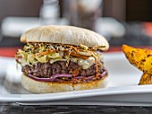 Duck burger with sesame seeds and Oriental vegetables