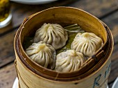 Stuffed dumplings in a bamboo steamer (Asia)