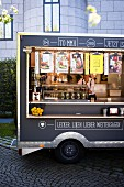 A food truck with various snacks