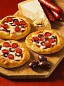 Mini peperoni and olive pizzas