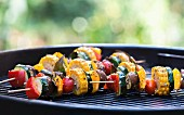 Mediterranean vegetable skewers on a barbecue