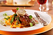 Veal escalope with crispy raw ham and herb mozzarella on green beans and tagliatelle