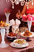 A festive buffet with various dishes and glasses of champagne