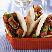 Pita bread with spicy sausages and coriander