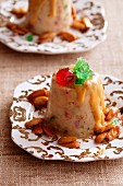 Chipotle pudding with candied fruits and almonds