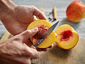 Nectarines being pitted