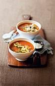 Tomato soup with tortellini and pesto