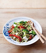 Barley salad with red peppers, broccoli, feta cheese and a pesto dressing