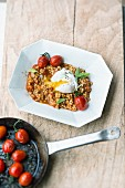 Tomato and barley risotto with garam masala and poached eggs