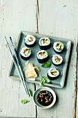 Vegetarian tomato and cucumber sushi with pine nuts