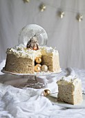 An angel cake with a snowglobe and brandy butter icing for Christmas