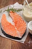 A fresh salmon steak, dill and mayonnaise