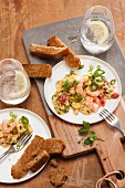Herb scrambled eggs with shrimps and spring onions