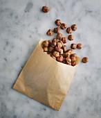 Hazelnuts in a paper bag