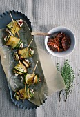 Courgette rolls with dried tomatoes