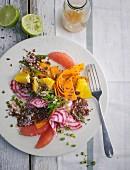 Quinoa salad with mange tout, carrots and grapefruit