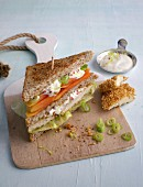 A wholemeal club sandwich with chicken
