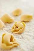 Fresh tortellini on a floured work surface
