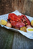 Cooked lobster with corn cobs and potatoes