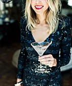 Woman Holding a glass of Martini