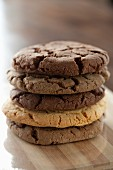 A stack of various chocolate chip cookies