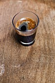 A glass of black coffee