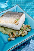 Baked hake with squid and mushy peas
