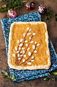 Mazurek (Polish Easter cake) with marmalade and flaked almonds