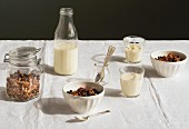 A breakfast table laid with muesli and milk