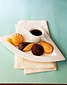 Various madeleines with a cup of coffee