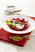 Mozzarella on a strawberry carpaccio with chocolate sauce