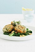 Fish cakes with garlic spinach