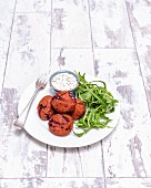 Beetroot falafel with yoghurt and rocket
