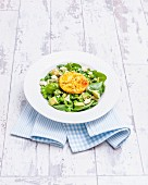 Baked eggs on pea and mint salad with feta cheese (England)