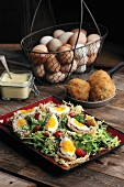 Scotch eggs on a mixed leaf salad