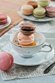 Macaroons in a tea cup and on a plate