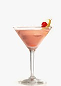 A pink cocktail on a white surface