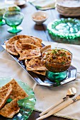 Pita chips with an almond and caper dip
