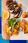 Duck breast with papaya salsa