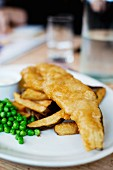 Fish and chips with peas in English restaurant