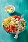 couscous and chickpea salad with avocado, cucumber and tomatoes