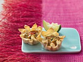 Filo pastry dishes filled with prawn ragout (Asia)