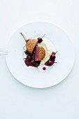 A venison chop with a chestnut crust on a bed of mashed celeriac and Port wine cherries
