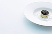 Potato timbale with caviar and lime cream