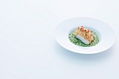 Catfish fillet with a horseradish crust on green pearl barley