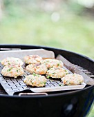 Rice fritters on a barbecue
