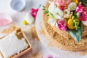 Russian honey cake decorated with colourful flowers