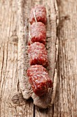 Italian salami on a wooden surface